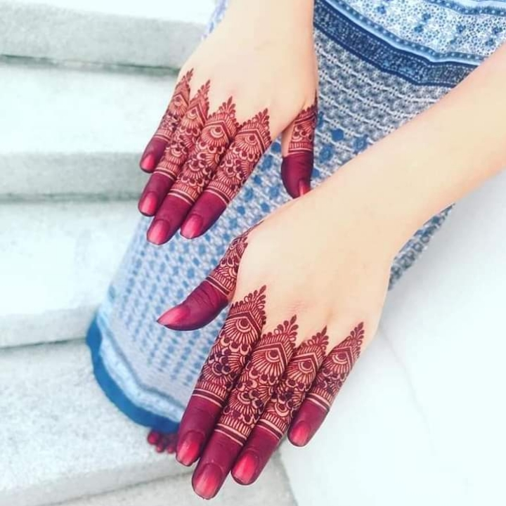 Red Henna on fingers